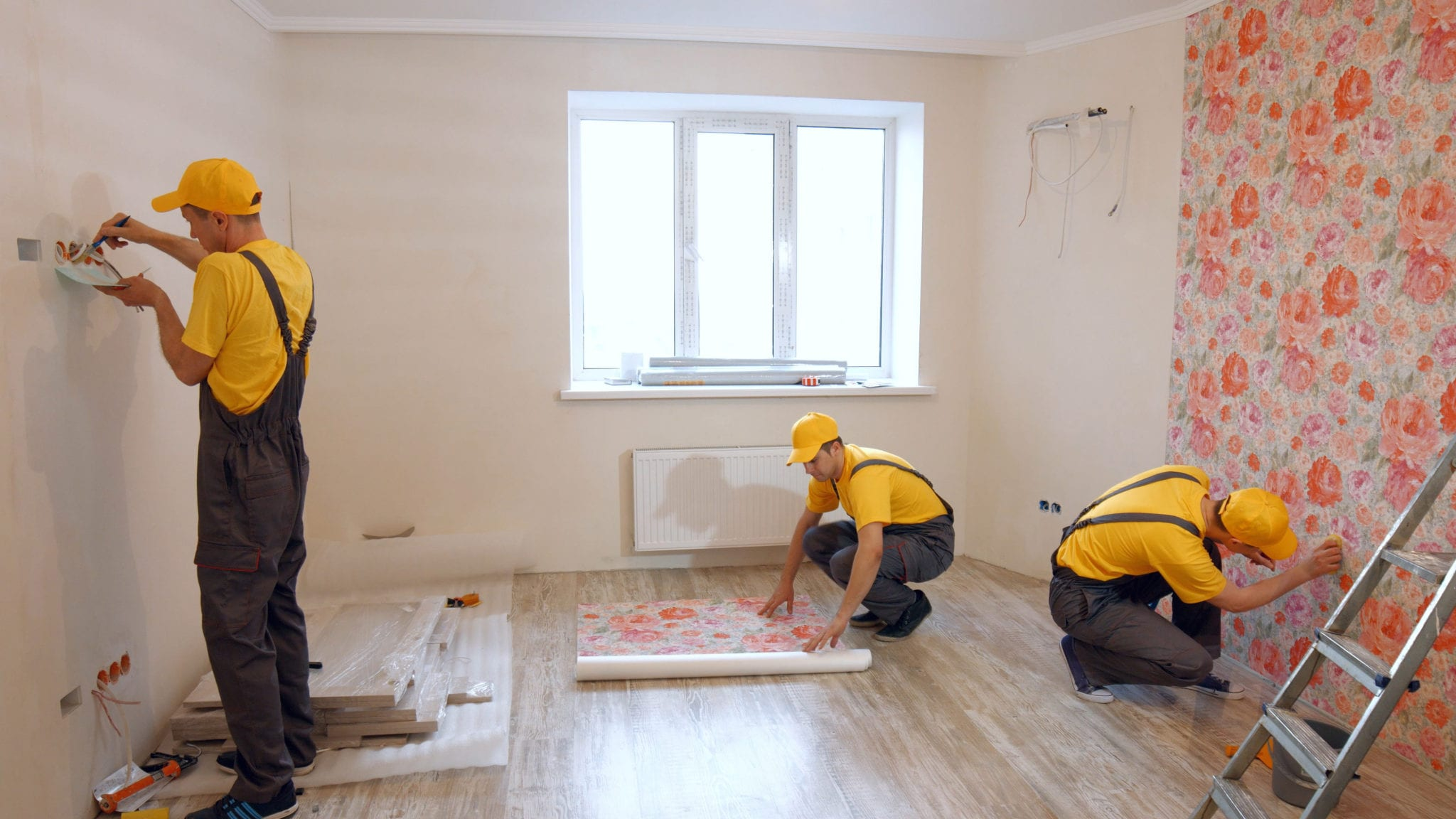 electricians contractors are setting the wiring system for home owner
